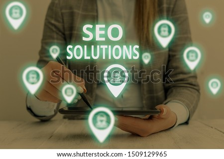 Text sign showing Seo Solutions. Conceptual photo Search Engine Result Page Increase Visitors by Rankings Woman wear formal work suit presenting presentation using smart device. #1509129965