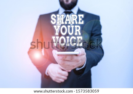 Text sign showing Share Your Voice. Conceptual photo asking employee or member to give his opinion or suggestion Male human wear formal work suit hold smart hi tech smartphone use one hand.
