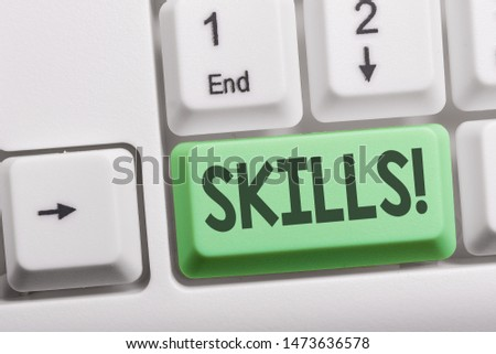 Text sign showing Skills. Conceptual photo ability do something very well by nature White pc keyboard with empty note paper above white background key copy space. #1473636578