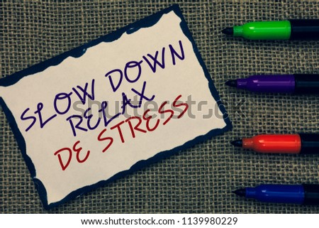 Text sign showing Slow Down Relax De Stress. Conceptual photo Have a break reduce stress levels rest calm Blue bordered page drawn some texts laid color pen jute background. #1139980229