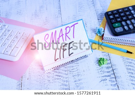 Text sign showing Smart Life. Conceptual photo approach conceptualized from a frame of prevention and lifestyles Notepaper stand on buffer wire in between computer keyboard and math sheets.