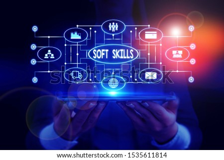 Text sign showing Soft Skills. Conceptual photo demonstratingal attribute enable interact effectively with other showing Woman wear formal work suit presenting presentation using smart device.