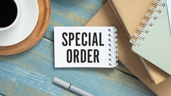 Text sign showing Special Order. A special item requested by the military headquarters for a daily note. White a blank sheet for notes on a wooden background.