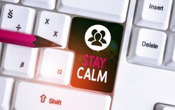Text sign showing Stay Calm. Conceptual photo Maintain in a state of motion smoothly even under pressure White pc keyboard with empty note paper above white background key copy space.