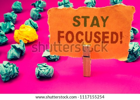 Text sign showing Stay Focused Motivational Call. Conceptual photos Maintain Focus Inspirational Thinking #1117155254