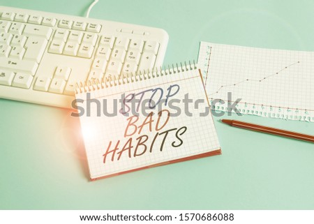 Text sign showing Stop Bad Habits. Conceptual photo asking someone to quit doing non good actions and altitude Paper blue desk computer keyboard office study notebook chart numbers memo.