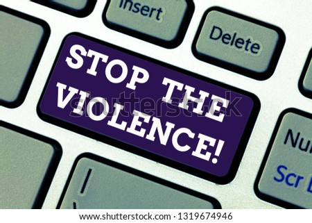 Text sign showing Stop The Violence. Conceptual photo program empowers youth with attitudes skills and resources Keyboard key Intention to create computer message pressing keypad idea. #1319674946