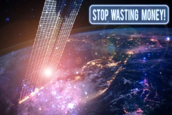 Text sign showing Stop Wasting Money. Conceptual photo advicing demonstrating to start saving and use it wisely Elements of this image furnished by NASA.