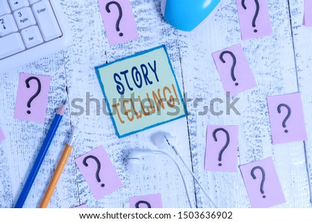 Text sign showing Story Telling. Conceptual photo activity writing stories for publishing them to public Writing tools, computer stuff and scribbled paper on top of wooden table.