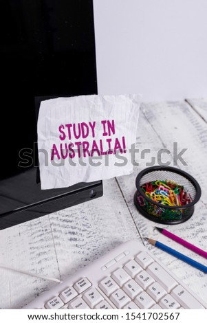Text sign showing Study In Australia. Conceptual photo going into foreign country order complete your studies Note paper taped to black computer screen near keyboard and stationary.