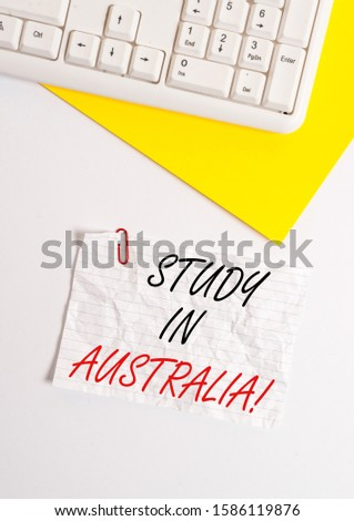 Text sign showing Study In Australia. Conceptual photo going into foreign country order complete your studies Flat lay above white blank paper with copy space for text messages.