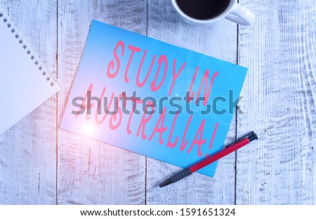Text sign showing Study In Australia. Conceptual photo going into foreign country order complete your studies Stationary placed next to a cup of black coffee above the wooden table.