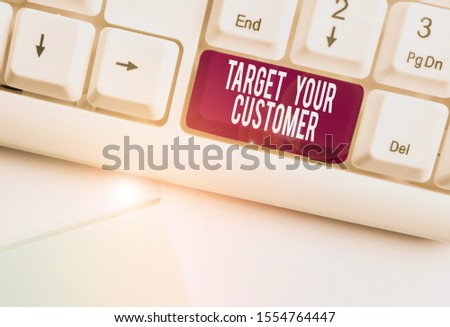 Text sign showing Target Your Customer. Conceptual photo Tailor Marketing Pitch Defining Potential Consumers White pc keyboard with empty note paper above white background key copy space.