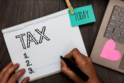 Text sign showing Tax. Conceptual photo Compulsory payment of taxes by people to government increase revenue Appointment daily graph paper love lovely hart laptop notebook netbook.