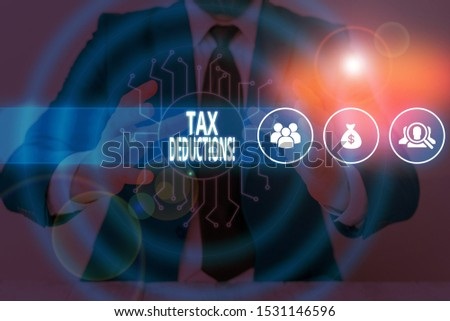 Text sign showing Tax Deductions. Conceptual photo reduction income that is able to be taxed of expenses Male human wear formal work suit presenting presentation using smart device. #1531146596
