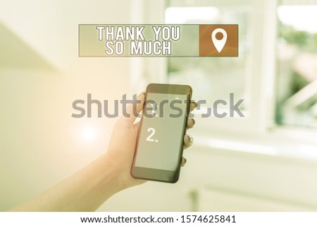 Text sign showing Thank You So Much. Conceptual photo Expression of Gratitude Greetings of Appreciation woman using smartphone office supplies technological devices inside home. #1574625841