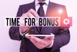 Text sign showing Time For Bonus. Conceptual photo a sum of money added to a demonstrating s is wages as a reward Male human wear formal work suit hold smart hi tech smartphone use one hand.