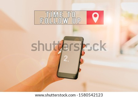 Text sign showing Time To Follow Up. Conceptual photo Enquiry of the previous task or information Continuation woman using smartphone office supplies technological devices inside home. #1580542123
