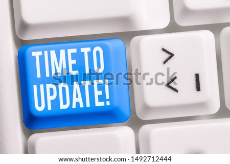 Text sign showing Time To Update. Conceptual photo act updating something someone or updated version program White pc keyboard with empty note paper above white background key copy space. #1492712444