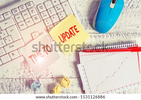 Text sign showing Time To Update. Conceptual photo act updating something someone or updated version program Writing equipments and computer stuffs placed above classic wooden table. #1531126886