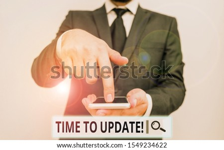 Text sign showing Time To Update. Conceptual photo act updating something someone or updated version program Male human wear formal work suit hold smart hi tech smartphone use one hand. #1549234622