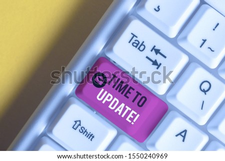 Text sign showing Time To Update. Conceptual photo act updating something someone or updated version program White pc keyboard with empty note paper above white background key copy space. #1550240969