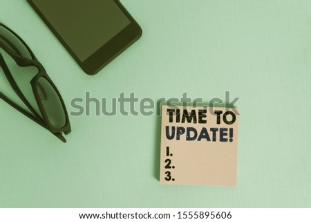 Text sign showing Time To Update. Conceptual photo act updating something someone or updated version program Dark eyeglasses colored sticky note smartphone fashion pastel background. #1555895606