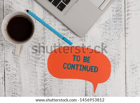 Text sign showing To Be Continued. Conceptual photo indicate that the story continues in the next episode Metallic open laptop speech bubble coffee cup ballpoint pen vintage table. #1456953812