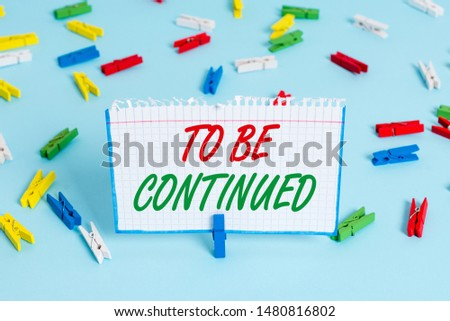 Text sign showing To Be Continued. Conceptual photo indicate that the story continues in the next episode Colored clothespin papers empty reminder blue floor background office pin. #1480816802