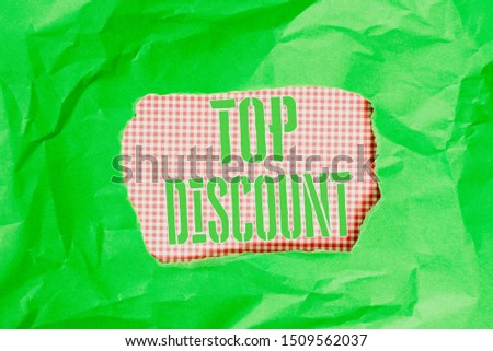 Text sign showing Top Discount. Conceptual photo Best Price Guaranteed Hot Items Crazy Sale Promotions Green crumpled ripped colored paper sheet centre torn colorful background.