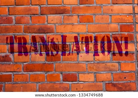 Text sign showing Translation. Conceptual photo Transform words or texts to another language Brick Wall art like Graffiti motivational call written on the wall. #1334749688