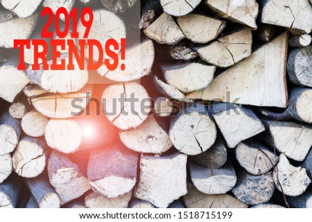Text sign showing 2019 Trends. Conceptual photo general direction in which something is developing or changing Background dry chopped firewood logs stacked up in a pile winter chimney.