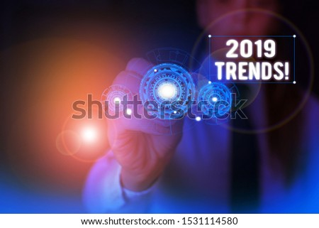 Text sign showing 2019 Trends. Conceptual photo general direction in which something is developing or changing Woman wear formal work suit presenting presentation using smart device.
