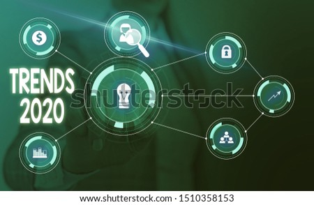 Text sign showing Trends 2020. Conceptual photo Upcoming year prevailing tendency Widely Discussed Online Woman wear formal work suit presenting presentation using smart device.