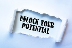 Text sign showing UNLOCK YOUR POTENTIAL