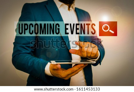 Text sign showing Upcoming Events. Conceptual photo the approaching planned public or social occasions Businessman with pointing finger in front of him.