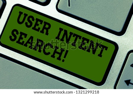 Text sign showing User Intent Search. Conceptual photo what demonstrating looking for when conducting searching query Keyboard key Intention to create computer message pressing keypad idea. #1321299218
