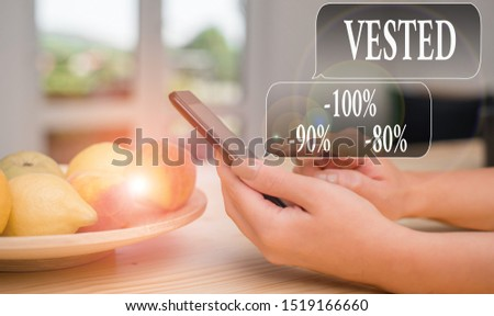 Text sign showing Vested 100 Percent 90 Percent 80 Percent. Conceptual photo Eligible for Retirement Benefit based on years of Service woman using smartphone office supplies technological devices
