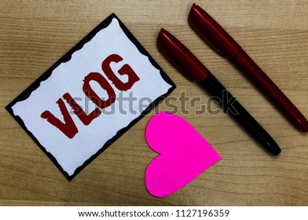 Text sign showing Vlog. Conceptual photo Entertaining multimedia self broadcasting news reporting stories Love pure wood colour hart marker pens art work black shadow memories.