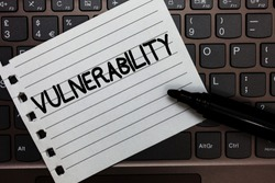Text sign showing Vulnerability. Conceptual photo State of being exposed to the possibility of being attacked Notebook piece paper keyboard Inspiration ideas Type computer black marker.
