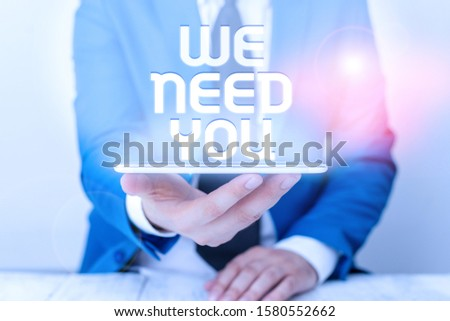 Text sign showing We Need You. Conceptual photo Company wants to hire Vacancy Looking for talents Job employment Businessman in blue suite with a tie holds lap top in hands.