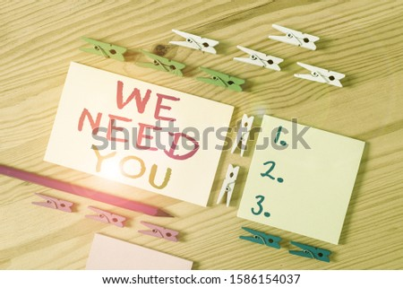 Text sign showing We Need You. Conceptual photo Company wants to hire Vacancy Looking for talents Job employment Colored clothespin papers empty reminder wooden floor background office.