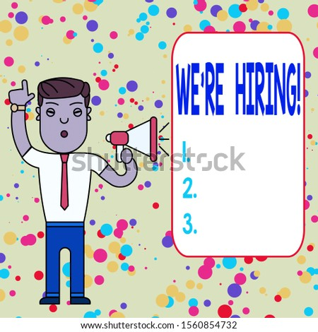 Text sign showing We Re Hiring. Conceptual photo recently employ someone or pay him to do particular job Man Standing with Raised Right Index Finger and Speaking into Megaphone.