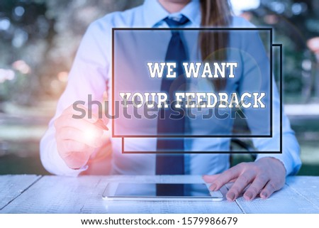 Text sign showing We Want Your Feedback. Conceptual photo to Improve Perforanalysisce or Product Timely Reaction Female business person sitting by table and holding mobile phone.