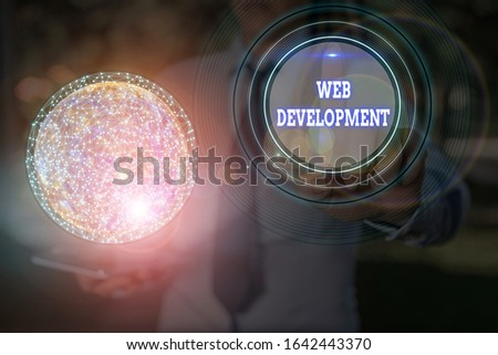 Text sign showing Web Development. Conceptual photo dealing with developing websites for hosting via intranet Elements of this image furnished by NASA.