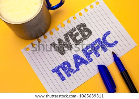 Text sign showing Web Traffic. Conceptual photo Internet Boost Visitors Audience Visits Customers Viewers written on Notebook Paper on the plain background Coffee Cup and Marker next to it. #1065639311