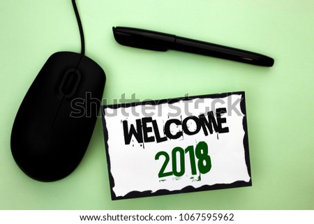 Text sign showing Welcome 2018. Conceptual photo Celebration New Celebrate Future Wishes Gratifying Wish written on Sticky Note Paper on the plain background Pen and Mouse next to it. #1067595962