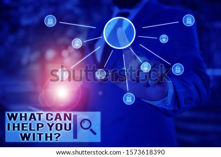 Text sign showing What Can I Help You With Question. Conceptual photo Offering assistance Experts advice ideas Male human wear formal work suit presenting presentation using smart device. #1573618390