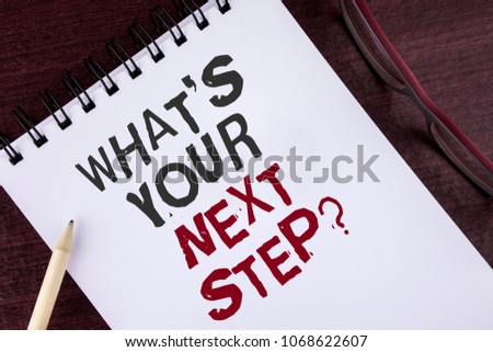 Text sign showing What iS Your Next Step Question. Conceptual photo Analyse ask yourself before taking decisions written Notepad the Wooden background Pencil and Glasses next to it.