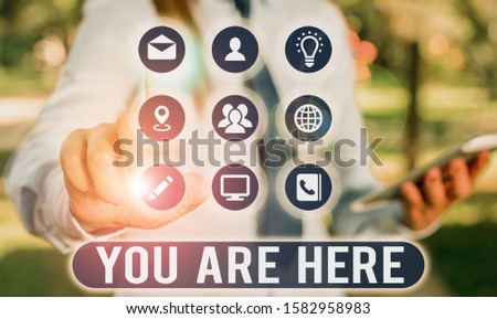 Text sign showing You Are Here. Conceptual photo This is your location reference point global positioning system. #1582958983